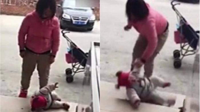 Mãe é flagrada agredindo bebê que chorava em rua; vídeo é chocante