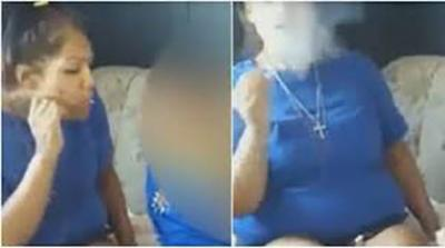 Mulher fuma maconha e sopra fumaça no rosto de criança
